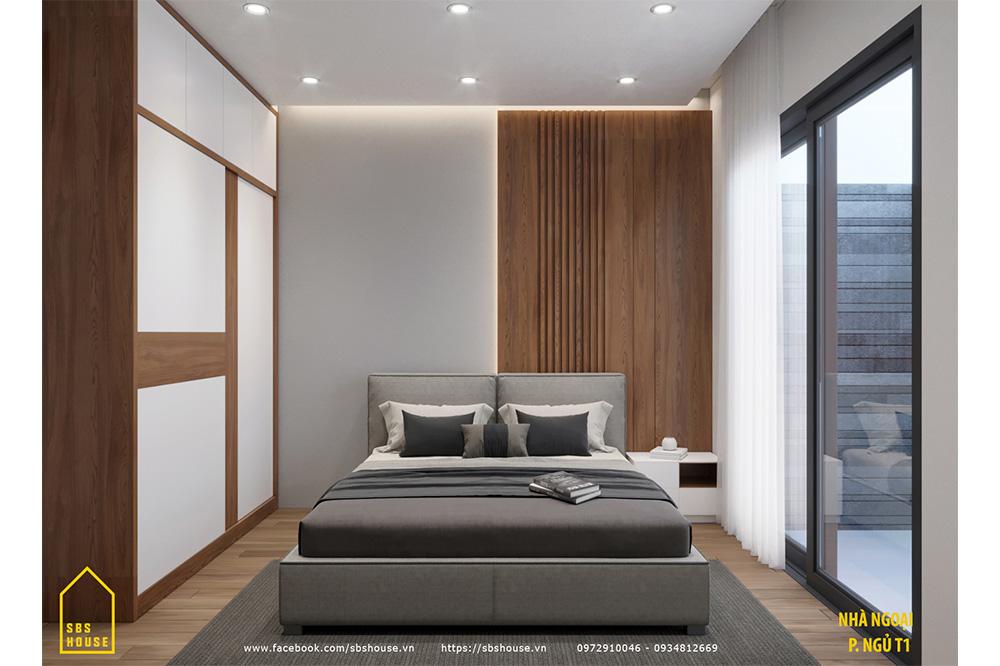Phòng ngủ tầng 1 với cửa mở ra vườn sau nhà